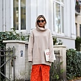 Style an Oversized Turtleneck With a Lace Skirt and Brown Boots