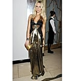 "Poppy Delevingne went for head-to-toe draped lamé at the Harper's Bazaar Women of the Year Awards in November 2011.  Shop the look: <iframe src=""http://widget.shopstyle.com/widget?pid=uid5121-1693761-41&look=4300184&width=3&height=3&layouttype=0&border=0&footer=0"" frameborder=""0"" height=""244"" scrolling=""no"" width=""286""></iframe>"
