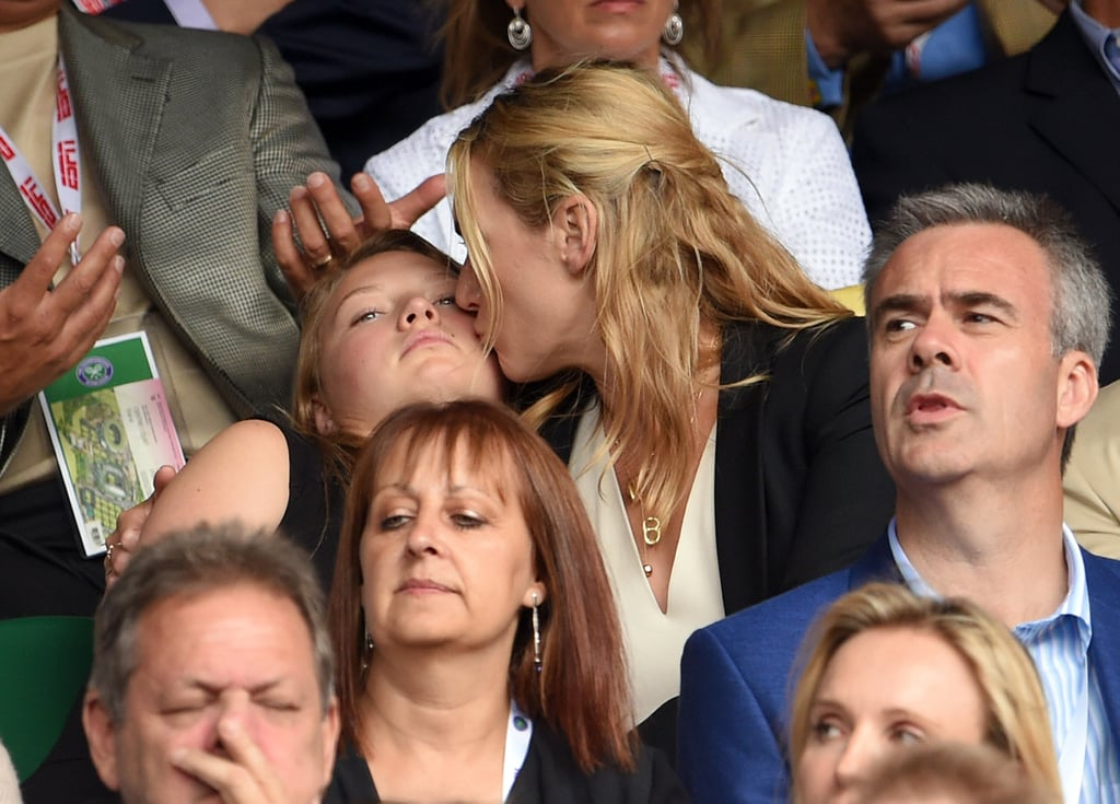 Kate Winslet stepped out for Wimbledon on Sunday, sitting in the stands with her 14-year-old daughter, Mia, and her 11-year-old son, Joe. At one point, the actress had her arm around Mia, and when she turned to give her a sweet kiss, her daughter looked sweetly embarrassed — or maybe just surprised? Kate and her kids sat in front of Clive Owen during the men's singles final match between Serbia's Novak Djokovic and Switzerland's Roger Federer, and she got animated as she watched, throwing her hands up in the air and cheering.  Kate isn't the only British star who's made an appearance at Wimbledon this year; Benedict Cumberbatch and Sophie Hunter attended Wimbledon over the weekend, too, and David Beckham managed to catch a stray ball during a tennis match on Thursday. Meanwhile, Kit Harington rubbed shoulders with royalty one day, and Kate Middleton cracked up with Prince William when they stepped out on day nine of the Wimbledon Championships. Keep reading for more pictures of Kate's day out with her kids.