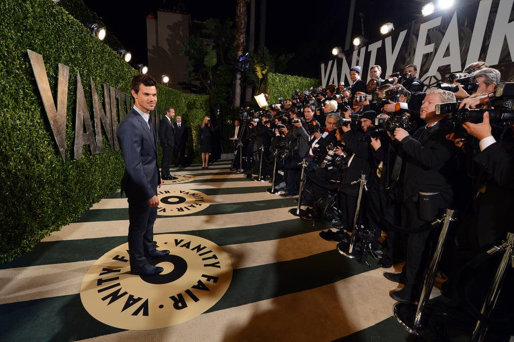 Taylor Lautner arrived at the Vanity Fair Oscar party on Sunday night.