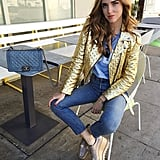 A Blue T-Shirt, Jeans, Platform Shoes, and a Metallic Jacket