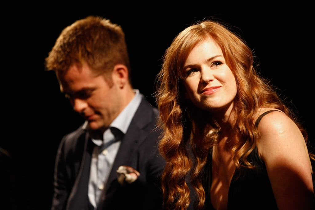 Isla Fisher wore her beachy waves in her long, red locks.