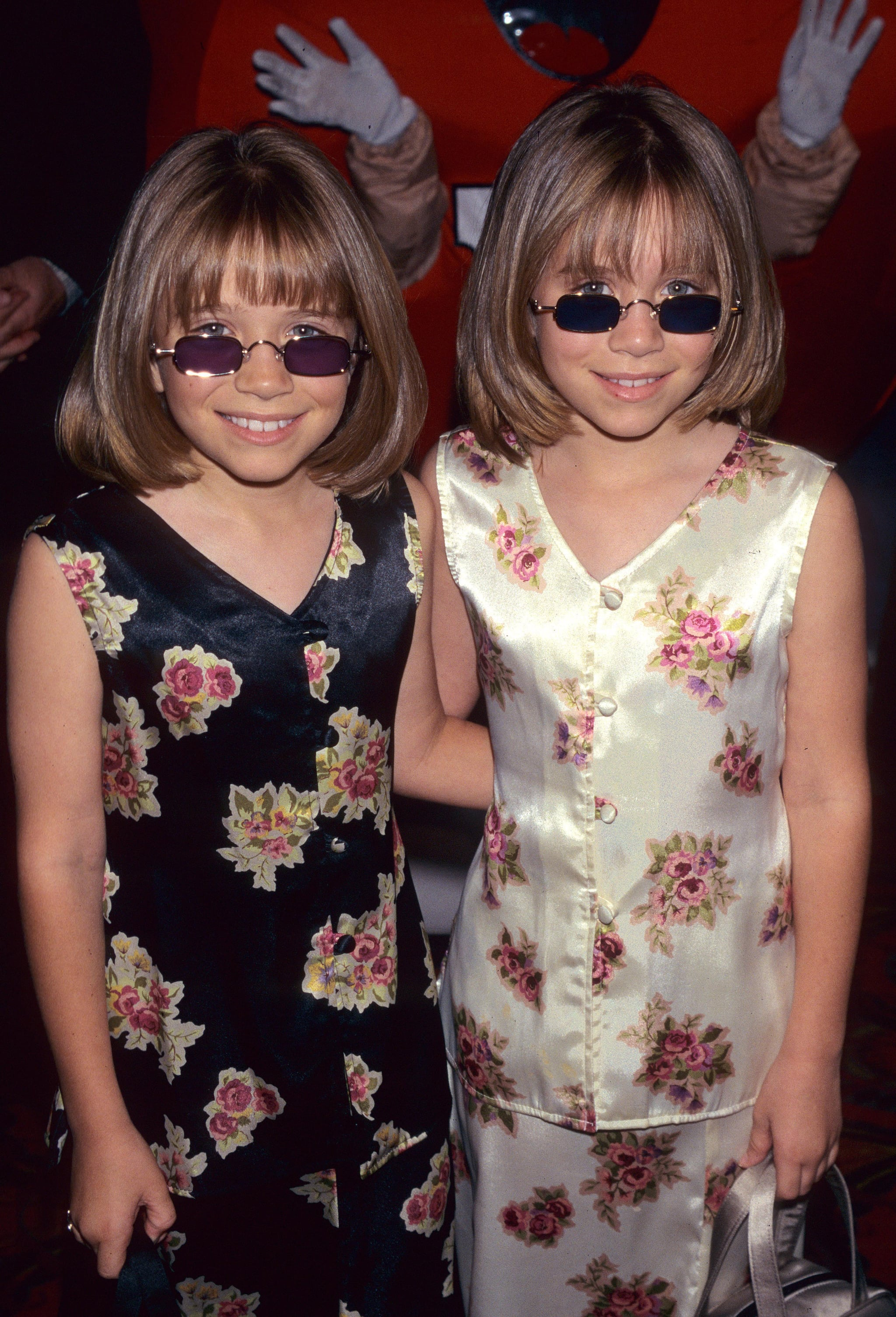 At the 1997 Audrey Hepburn Hollywood For Children Family Film Festival, the pair got groovy in silk floral outfits, chin-length cuts, and purple sunglasses.
