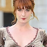Singer Florence Welch was out in London for a preview of the Royal Academy of Arts Summer Exhibition. She wore her red mane in a crown of braids that accented her blunt bangs and wispy curls.