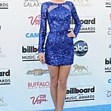 Her 2013 Billboard Music Awards style was all about the blues. Donning an electric Zuhair Murad Pre-Fall 2013 look that accentuated her mile-long legs with a navy knuckle ring and coordinating sultry makeup.