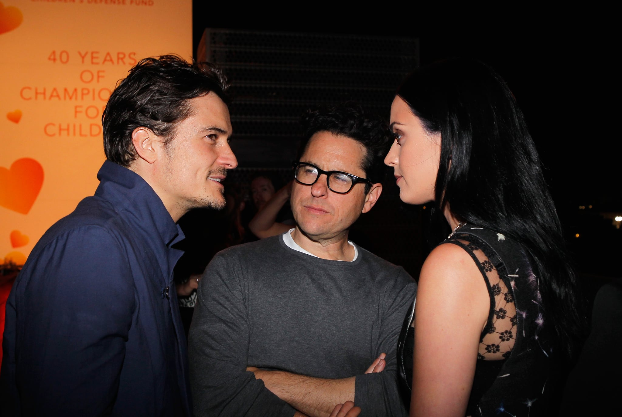 SANTA MONICA, CA - APRIL 10:  (l-R) Actor Orlando Bloom, host J.J. Abrams, and singer Katy Perry attend Coach's 3rd Annual Evening of Cocktails and Shopping to Benefit the Children's Defence Fund hosted by Katie McGrath, J.J. Abrams and Bryan Burk at Bad Robot on April 10, 2013 in Santa Monica, California.  (Photo by Donato Sardella/Getty Images for Coach)