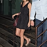 We first spied Taylor carrying this Aldo bag around October. Here, she chose to dress it up, wearing it with a floral LBD.