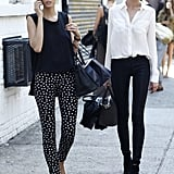 Color-coordinated model friends in two equally chic white and black looks — how sweet are those polka-dot pants? Source: Greg Kessler