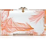 We love this subtly chic clutch with its fresh-feeling print and juicy tangerine hue.  Charlotte Olympia Pandora Feather Perspex Box Clutch ($995)