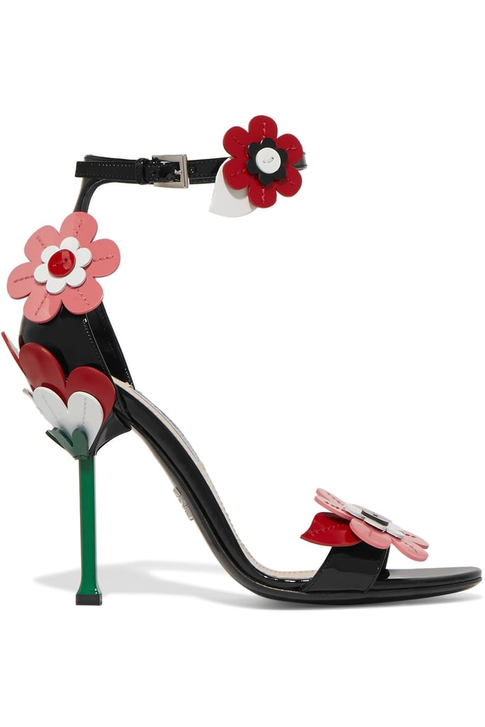 Prada's Floral Appliquéd Patent Leather Sandals ($1,125) are a quick trip to the garden.