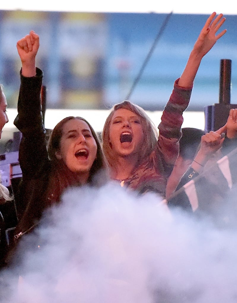 Taylor Swift is known for dancing in the crowd during award shows, and she brought that same all-out enthusiasm when she watched her rumoured boyfriend, Calvin Harris, perform during KIIS FM's Wango Tango concert in LA on Saturday. The singer was seen rocking out backstage with her friends Este and Alana Haim at the show, and a source told E! News that Taylor and Calvin were spotted kissing and holding hands after he finished his set, later leaving the StubHub Center together. Their backstage PDA comes just a couple weeks after they were seen riding in a car together in LA, and in April, they were pictured holding hands during a night out in LA. Keep reading for pictures of Taylor and Calvin's night out, and since Taylor is among the nominees, vote for the star with the best fan base in our POP 100 poll!