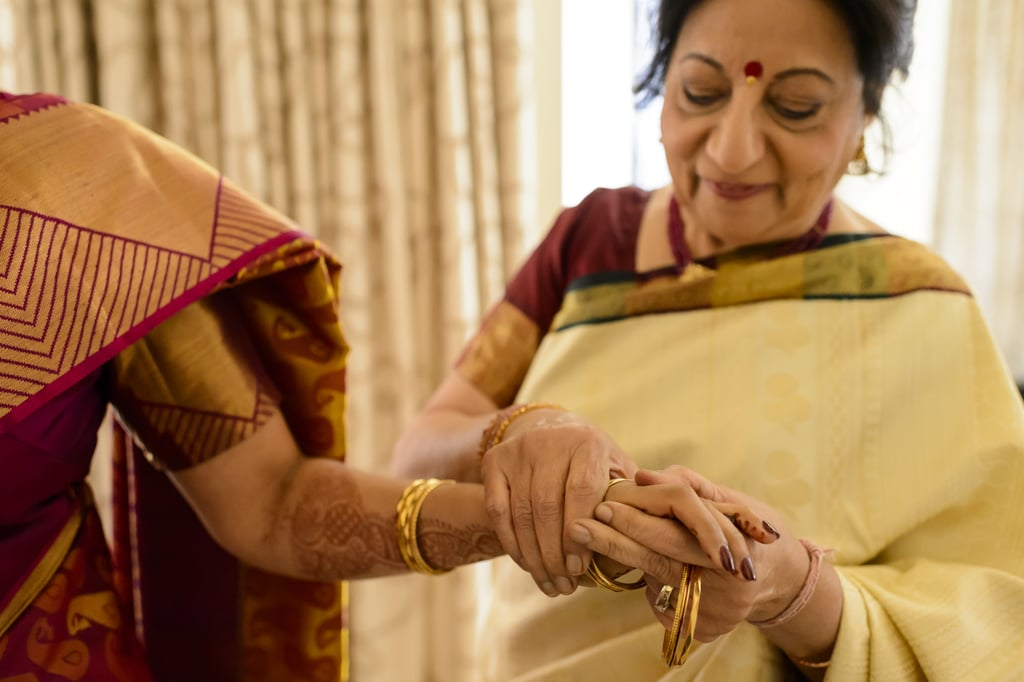 They had Mehndi applied as a part of their traditional Hindu ceremony. Photo by Chrisman Studios
