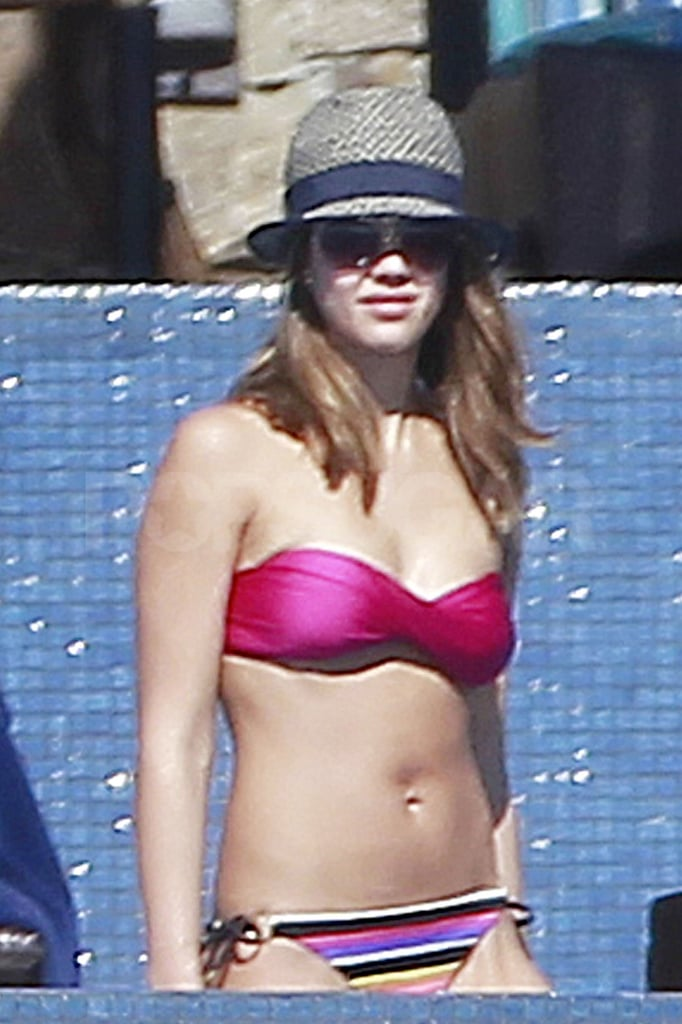 Jessica Alba waded in the water in Cabo in a strapless bikini top.