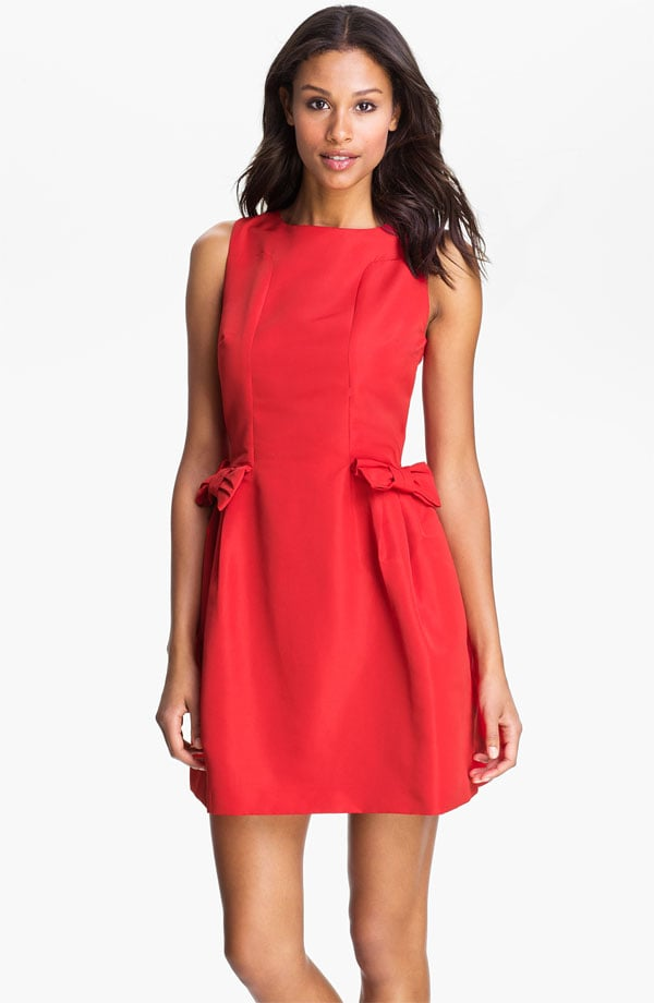 The holidays will be a lot more festive and fabulous if you wear this Taylor Dresses red bow dress ($148). How sweet are the bows on the hips? Throw on black patent pumps for a shiny finish.