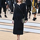 Olivia Palermo ditched colour and stuck to black at Burberry Prorsum's Spring '14 show, looking every bit the NYC lady. She did add pops of bright via her printed clutch and ankle-strap sandals.