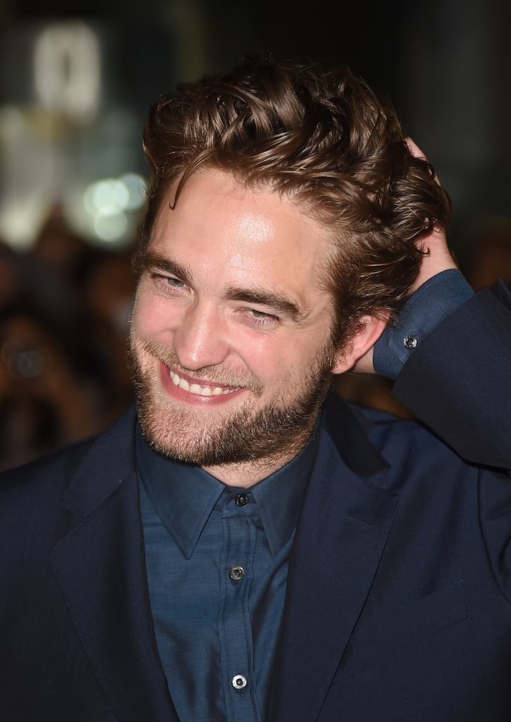 Rob was glowing with a hand on his head at the Toronto International Film Festival in September 2014.