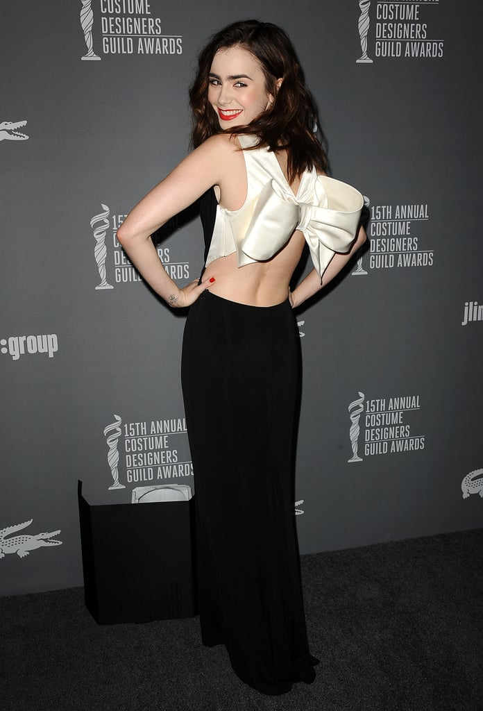 Lily Collins wore a giant bow.