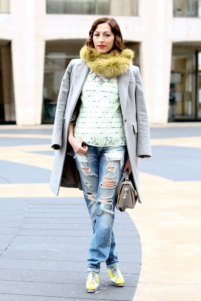 A fur snood and polished outerwear easily elevated distressed denim.