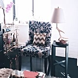 The finds: this ikat-printed chair and sequined chevron pillow.