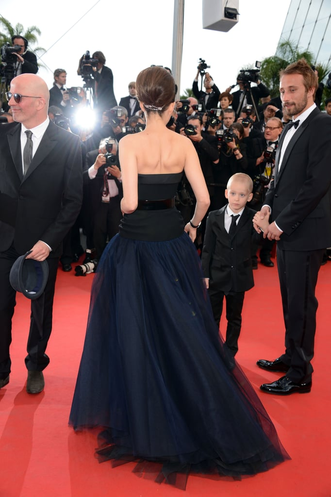 Marion's updo showed off the strapless back, and we got a view of the gown's tulle layers.