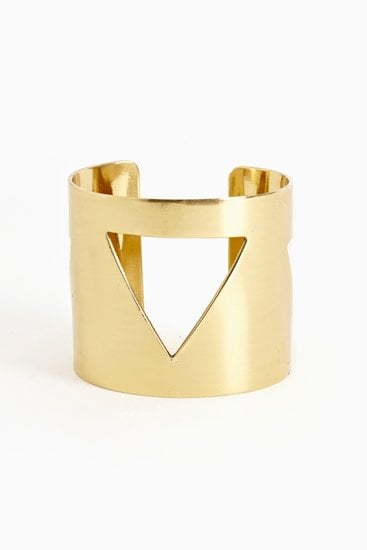 This Nasty Gal pyramid cutout cuff ($20) would be a sleek complement to a silk maxi dress at any Summer wedding.