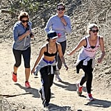 Vanessa Hudgens showed skin when she went for a hike with friends on Wednesday in LA.