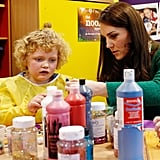 Kate looked serious while painting at a children's hospital in January 2017.