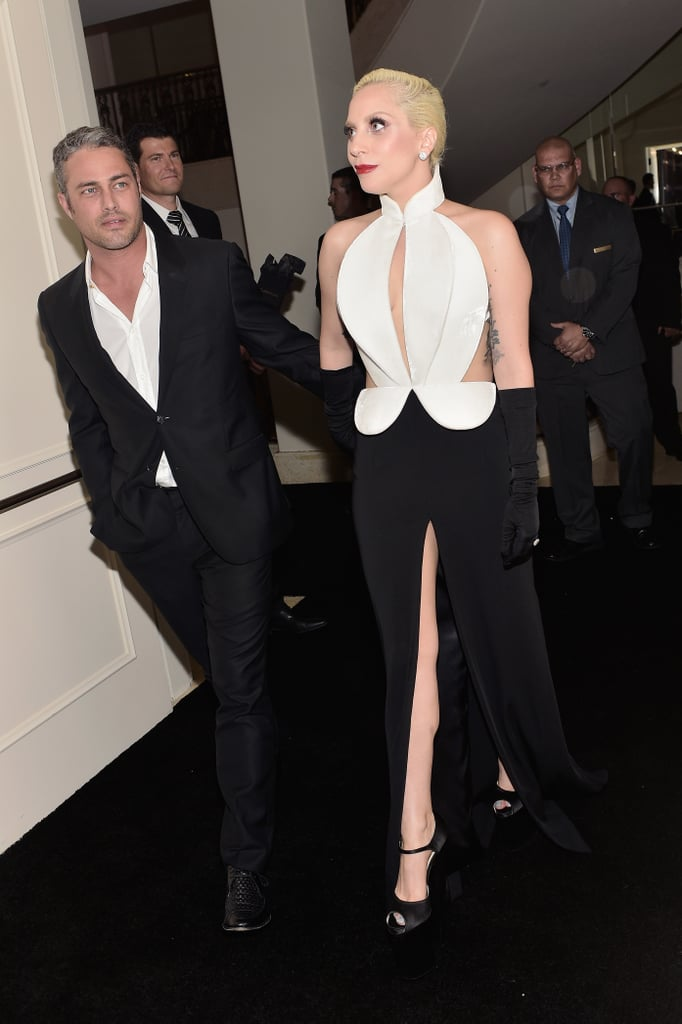 """Lady Gaga attended The Weinstein Company's pre-Oscars dinner in Beverly Hills with her superhot fiancé, Taylor Kinney, by her side on Saturday. The pair channeled Old Hollywood glamour in coordinating black-and-white ensembles, and although Taylor skipped the red carpet, he was spotted with his arm around Lady Gaga's waist while walking backstage.  In addition to presenting at this year's Oscars, Lady Gaga is also returning to the award ceremony as a first-time nominee for best original song for """"Til It Happens to You,"""" from The Hunting Ground. Keep reading to see more of Lady Gaga, and then check out her sweetest pictures with Taylor."""