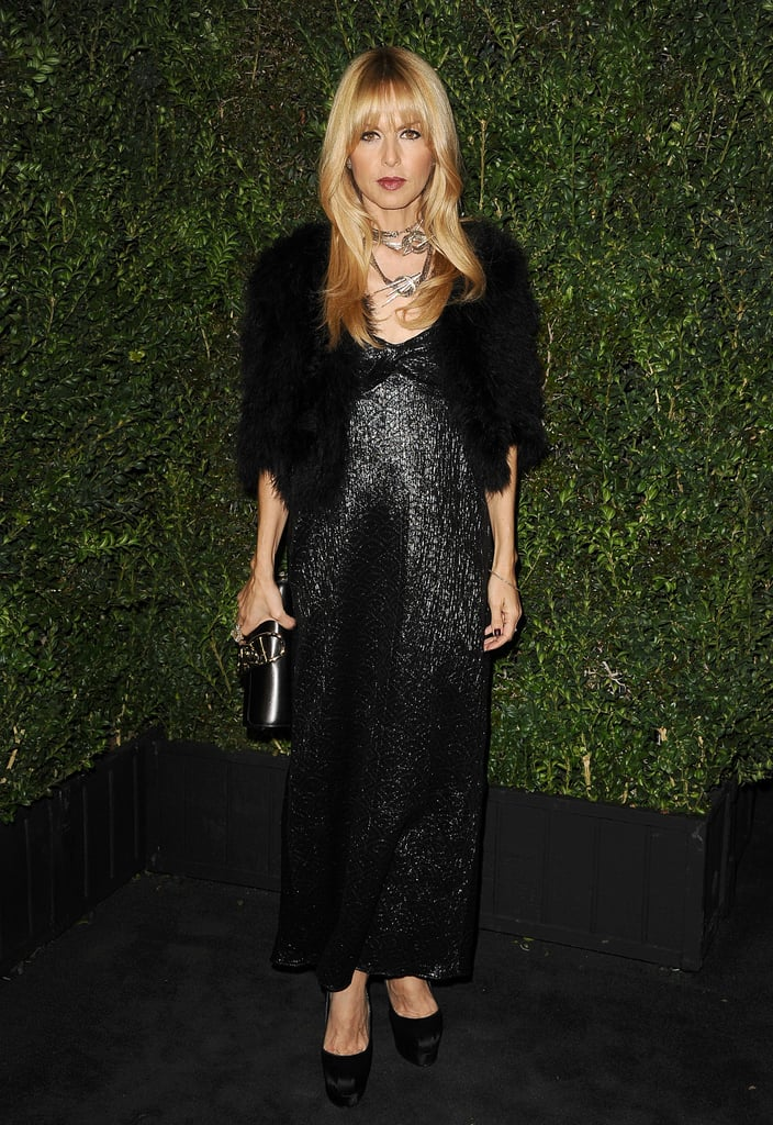 Rachel Zoe shimmered in a black embellished gown and cropped jacket, striking the right mix of bohemian quirk and all-out glamour.