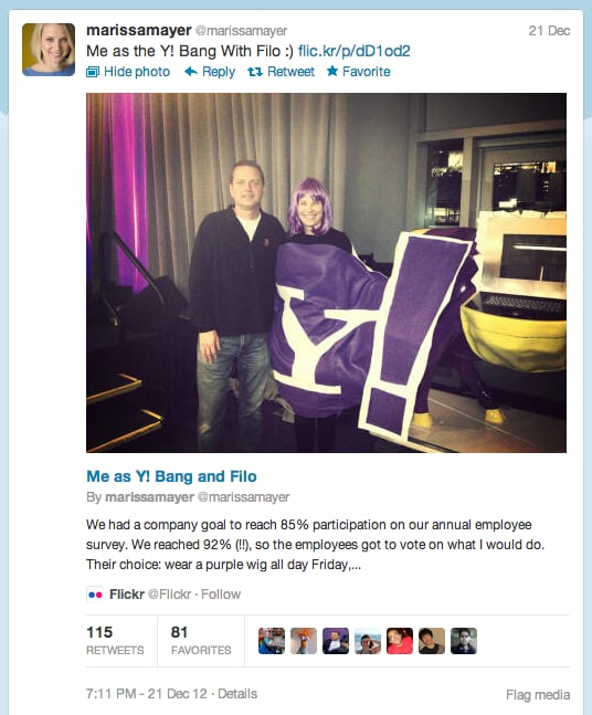 Yahoo! reached its goal of 85 percent participation in an annual employee survey, and employees voted that CEO Marissa Mayer (here with Yahoo! cofounder David Filo) wear a purple wig, dress as the Y! Bang, and pose for pictures with a purple cow.