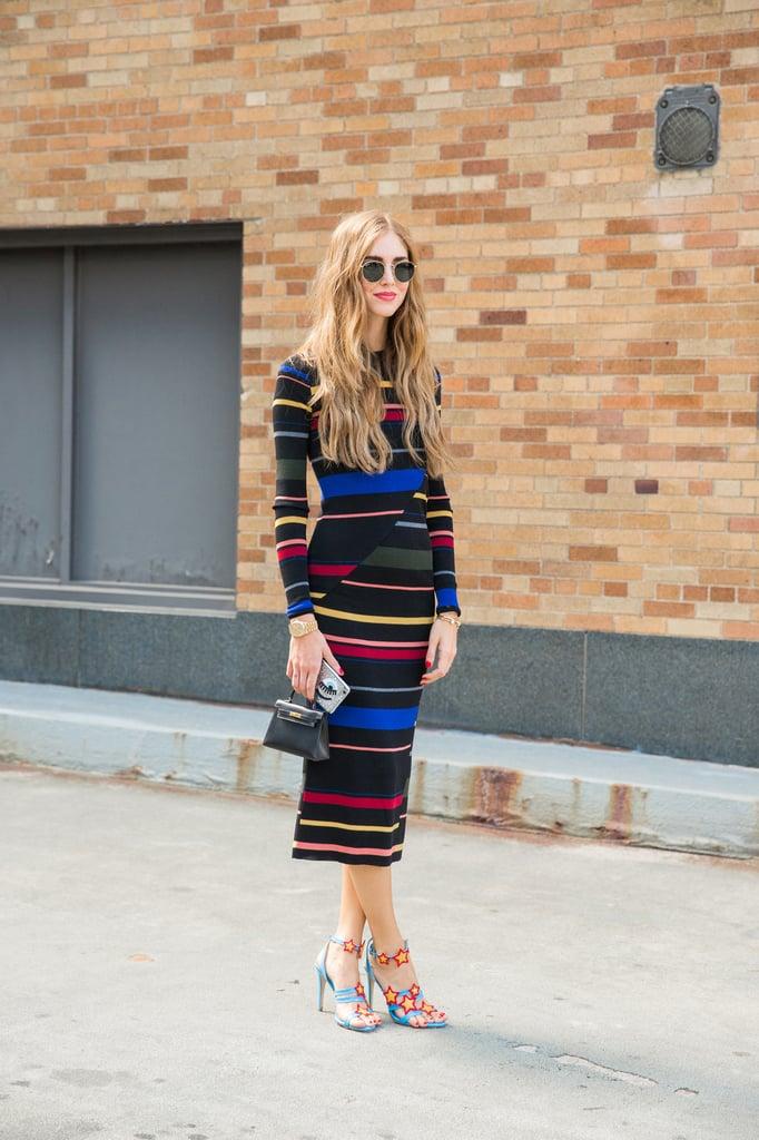 Chiara Ferragni wearing a Stella McCartney dress and Chiara Ferragni collection sandals and carrying an Hermès mini Kelly bag.