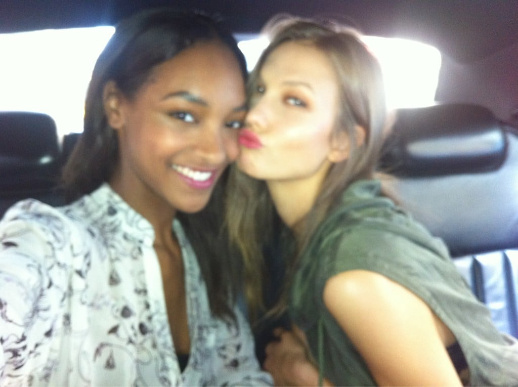 Jourdan and Karlie shared a peck (their signature pose) while en route.