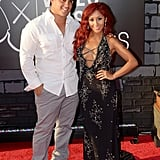 """Nicole """"Snooki"""" Polizzi posed with her husband, Jionni LaValle, at the VMAs."""