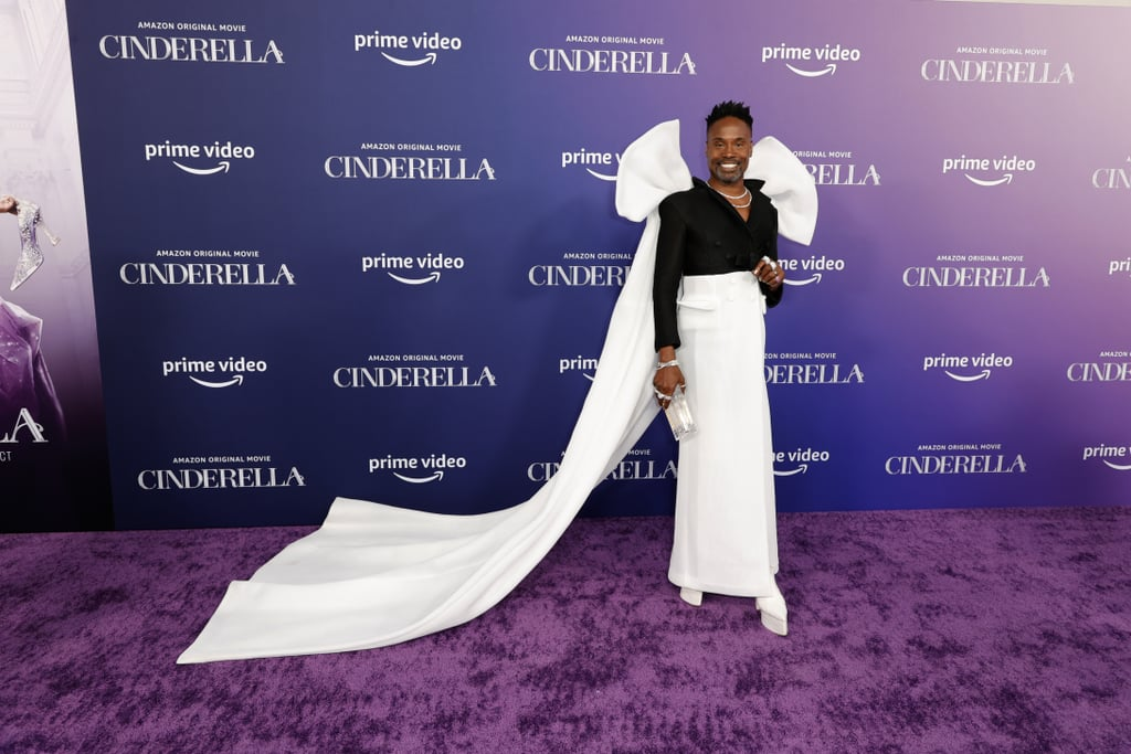"""Leave it to IRL fairy godparent Billy Porter to look bibbidi bobbidi beautiful at the Cinderella remake red purple carpet premiere. Sprinkling a little bit of magic beyond the screen, Billy attended the enchanting event in a two-toned Benchellal Collection No. 9 coat gown with a collared black bodice and white skirt. The skirt even featured pockets just spacious enough to carry a magic wand or a spare glass slipper.  Sharing his look on Instagram, Billy, who will play Cinderella's genderless fairy godparent Fab G in the 2021 remake, wrote, """"#MagicHasNoGender"""". He paired the look with a glittery gold manicure, a L'Afshar lucite clutch, thigh-high lace-up Harry Halim Paris white boots with six-inch heels, and H. Crowne jewellery — including a statement ring on all 10 fingers. Needless to say, we wish we had our own fairy godparent to conjure up an outfit half as magical as this. See Billy's full premiere gown from all angles here.        Related:                                                                                                           Mark Your Calendars — Here's Exactly When Cinderella Will Debut on Amazon Prime Video"""