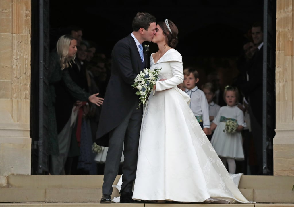 Princess Eugenie and Jack Brooksbank sealed their love with a kiss! Shortly after tying the knot at Windsor Castle's St. George's Chapel on Oct. 12, the couple showed off their newlywed glow as they stepped out on the steps for their first kiss as a married couple. Eugenie was a vision in a white gown by British designer Peter Pilotto, while her dashing husband wore a suit.  While the first kiss has become iconic within the royal family, the tradition hasn't been around that long. It first started with Prince Charles and Princess Diana's wedding in 1981 and has since been followed by Eugenie's parents, Prince Andrew and Sarah Ferguson, in July 1986 as well as Kate Middleton and Prince William in 2011 and Prince Harry and Meghan Markle earlier this year. See Eugenie and Jack's sweet smooch from all angles ahead!       Related:                                                                                                           Here Comes the Bride! See Every Photo From Princess Eugenie and Jack Brooksbank's Wedding