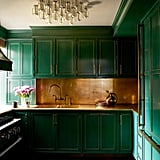 This deep jade kitchen will remind Slytherins of their house colors while also providing all the luxury they desire at home.