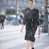 A knee-length dress with swirlings of sequins and a flattering sash at the waist will look appropriate with closed-toe shoes.