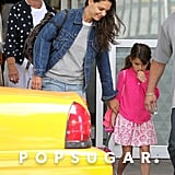 Suri Cruise and Katie Holmes landed at JFK Airport with Katie's mom, Kathleen.
