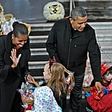 The president and first lady offerred treats to the little kids at the White House before Halloween.