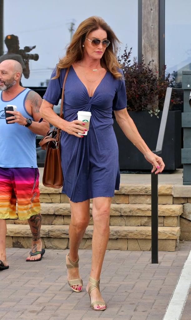 Caitlyn's blue cold-shoulder mini flattered her figure and also went perfectly with her neutral accessories: metallic ankle-strap wedges and a few complementing gold necklaces and rings. She finished her look with aviator sunglasses and a brown satchel.