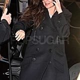 Katie Holmes wore black shades and a black peacoat as she stepped out of an SUV in NYC.