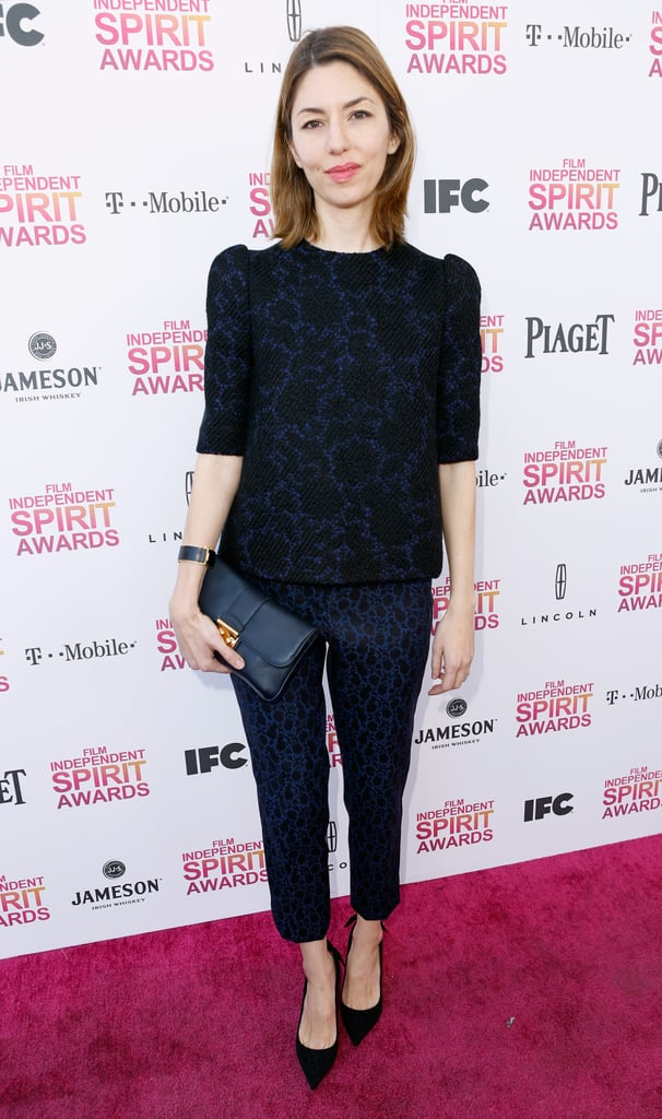 Sofia Coppola opted for a more subtle texture by way of this head-to-toe blue printed outfit by Louis Vuitton. She finished it all off with a dark clutch and black, pointy-toe pumps.