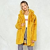 Brighten up the Winter slump in a vibrant hue, a la the Nasty Gal Surfin' Bird Faux Fur Coat ($190).