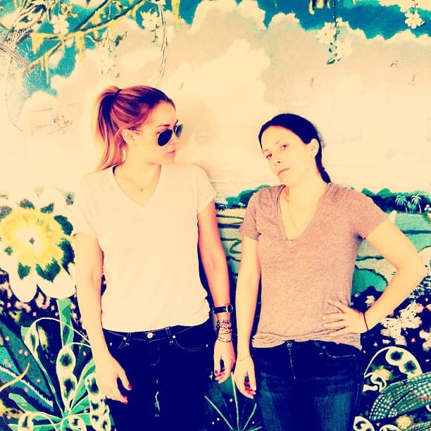 Lauren Conrad posed near a pretty background with a friend. Source: Instagram user laurenconrad