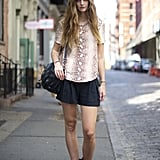 The silhouettes are simple, but a snake-print blouse is one of the chicest ways to top this look.
