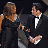 Queen Latifah joined John Travolta in presenting the award for best original song.