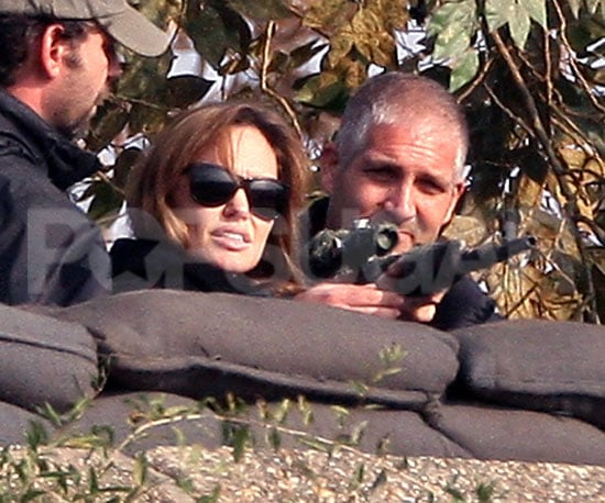 Slide Picture of Angelina Jolie Shooting a Gun in Hungary