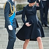 Prince William helped a pregnant Kate along as they attended a March service for troops in London.