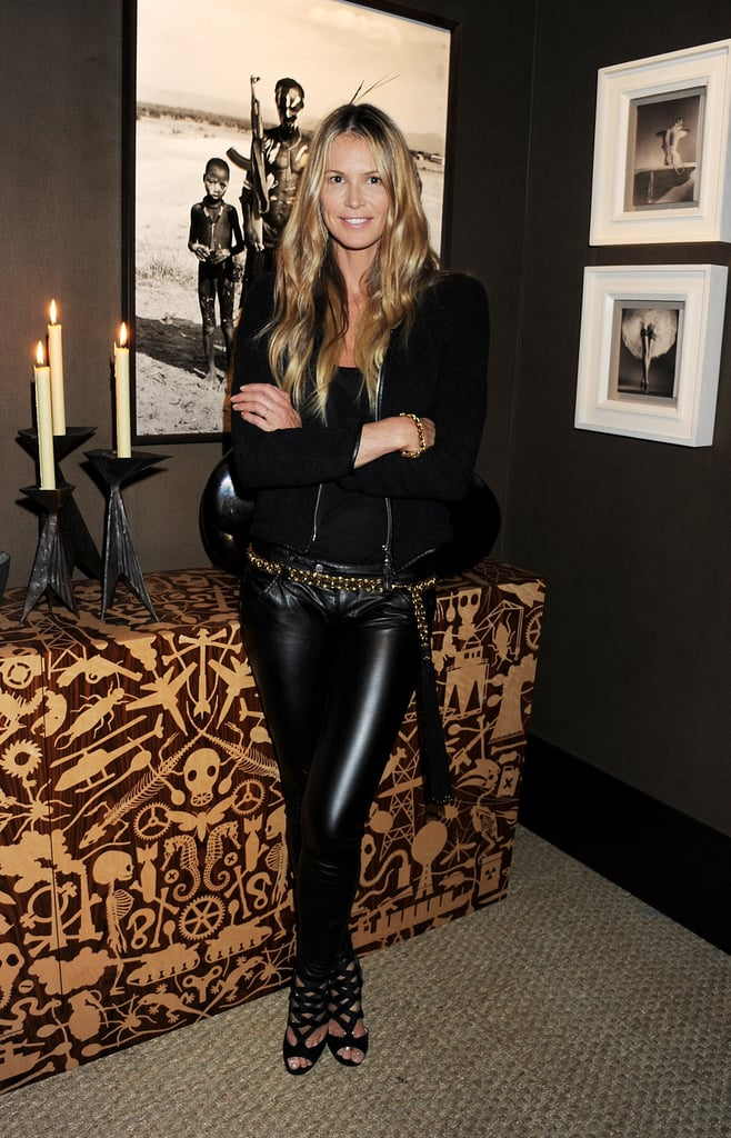 Elle loves leather, and she pulls it off every time. Here she kept her pants classic with a gypsy edge via a black zip jacket, caged sandals, and a gold chain belt around her waist.       Sandals by Stuart Weitzman