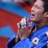 South Korea's Jae-Bum Kim celebrated after winning his judo contest final match.